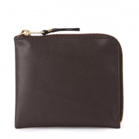 Comme Des Garçons brown leather coin pocket.