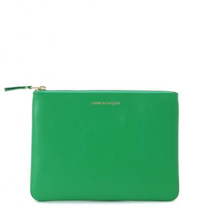 Pochette Comme des Garçons in pelle verde con zip dorata