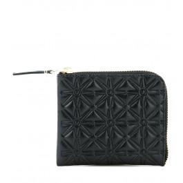 Cartera Comme des Garcons wallet en piel con estampado negro